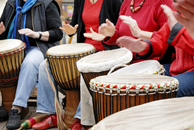 Senior Men and Women in Drumming Circle