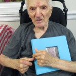Louie holding on to his scrapbook. He will be turning 100 in September!