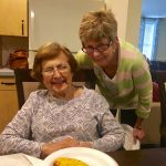 Carmella and Robin with their golden pizza pocket, fresh out of the oven!
