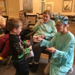Sue taste-tests a lollipop as she passes out candy with Maryanne who was the Statue of Liberty!