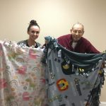 Diana and Dino display the finished blankets!