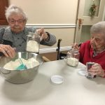 Audrey and Margo get started measuring their flour