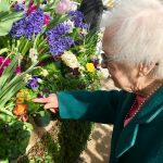 Shirley pointing out a unique flower she liked!