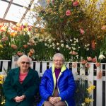 Shirley and Audrey taking a quick rest on a bench in the flower garden!